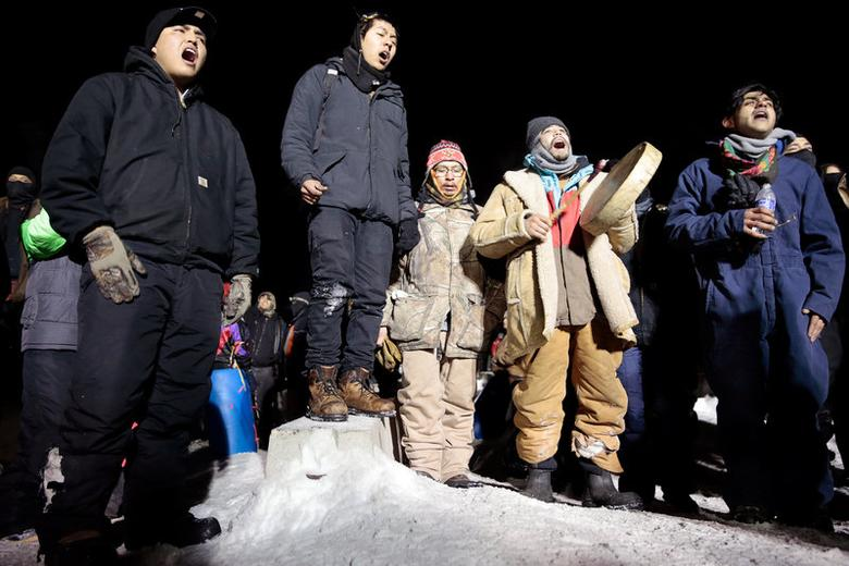 Opponents of the Dakota Access oil pipeline sing during a confrontation with police on Backwater Bridge near Cannon Ball, North Dakota, U.S., January 19, 2017. REUTERS/Terray Sylvester