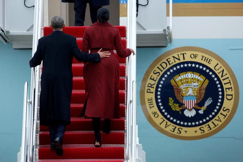 Obama and Michelle board Special Air Mission 28000, a Boeing 747 which serves as Air Force One. REUTERS/Brendan McDermid