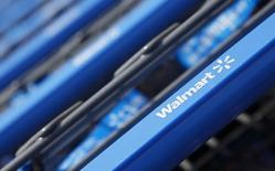 FILE PHOTO - Shopping carts are seen outside a new Wal-Mart Express store in Chicago July 26, 2011. REUTERS/John Gress/Files