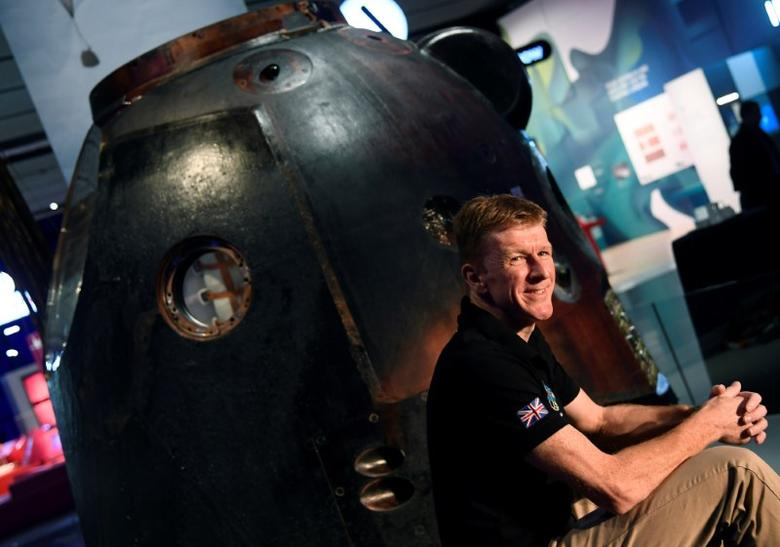 British astronaut Tim Peake poses with the Soyuz TMA-19M descent module, the spacecraft which carried him and his crew to and from the International Space Station, at a media event at the Science Museum in London, Britain, January 26, 2017. REUTERS/Toby Melville