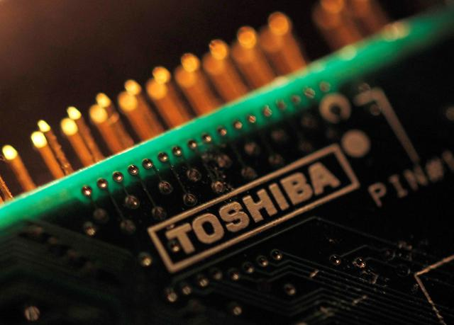 FILE PHOTO- A logo of Toshiba Corp is seen on a printed circuit board in this photo illustration taken in Tokyo July 31, 2012. REUTERS/Yuriko Nakao/File Photo