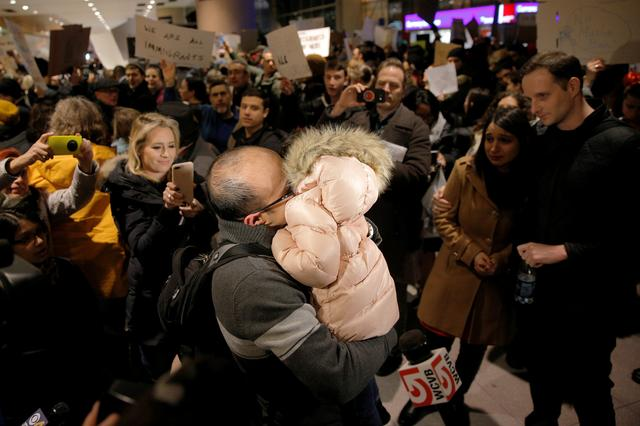 The Bay family is reunited after Hamed Bay was separated from other passengers and questioned as a result of U.S. Donald Trump's executive order travel ban, at Logan Airport in Boston, Massachusetts, U.S. January 28, 2017.  Hamed Bay was traveling back to the U.S. after visiting his sick father in Iran.  REUTERS/Brian Snyder