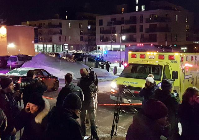 An ambulance is parked at the scene of a fatal shooting at the Quebec Islamic Cultural Centre in Quebec City, Canada January 29, 2017. REUTERS/Mathieu Belanger
