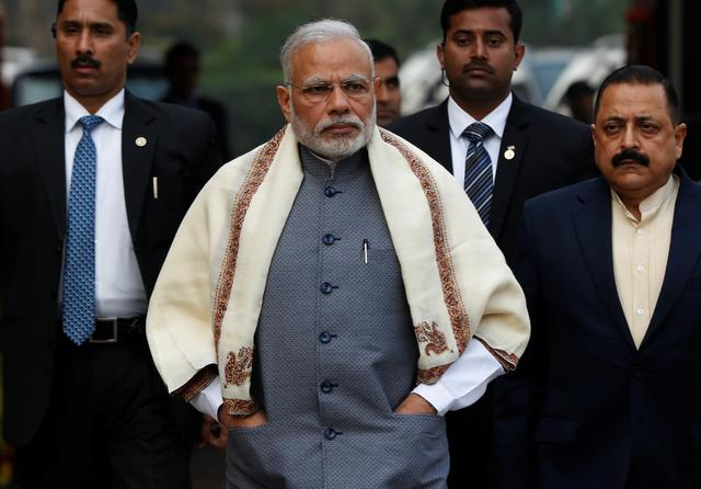 Prime Minister Narendra Modi walks to speak with the media as he arrives at the parliament house to attend the first day of the budget session, in New Delhi, January 31, 2017. REUTERS/Adnan Abidi