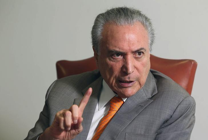 Brazil's President Michel Temer, gestures during an interview with Reuters at his office in Brasilia, Brazil, January 16, 2017. REUTERS/Adriano Machado/Files