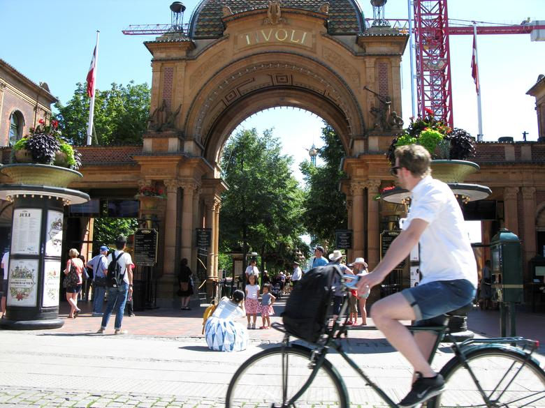 FILE PHOTO:People pass in front of an entrance to the Tivoli Gardens in Copenhagen, Denmark, July 22, 2016. REUTERS/Jacob Gronholt-Pedersen/File Photo