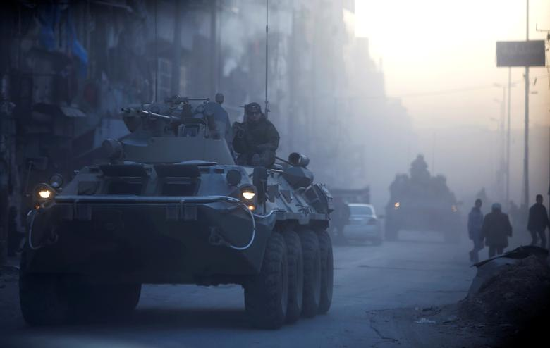 Russian soldiers, on armoured vehicles, patrol a street in Aleppo, Syria. REUTERS/Omar Sanadiki