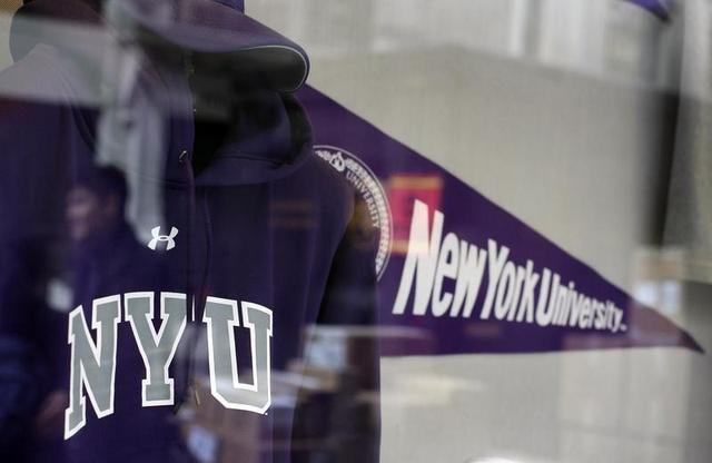 A sweatshirt and pennant are seen inside the bookstore at New York University in New York, October 21, 2009.  REUTERS/Shannon Stapleton
