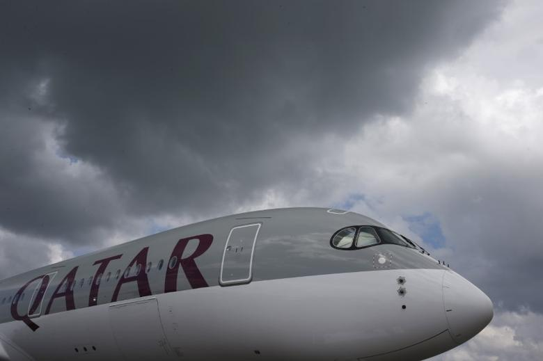 FILE PHOTO: A Qatar Airways Airbus A350 XWB aircraft is displayed at the Singapore Airshow at Changi Exhibition Center February 18, 2016.  REUTERS/Edgar Su