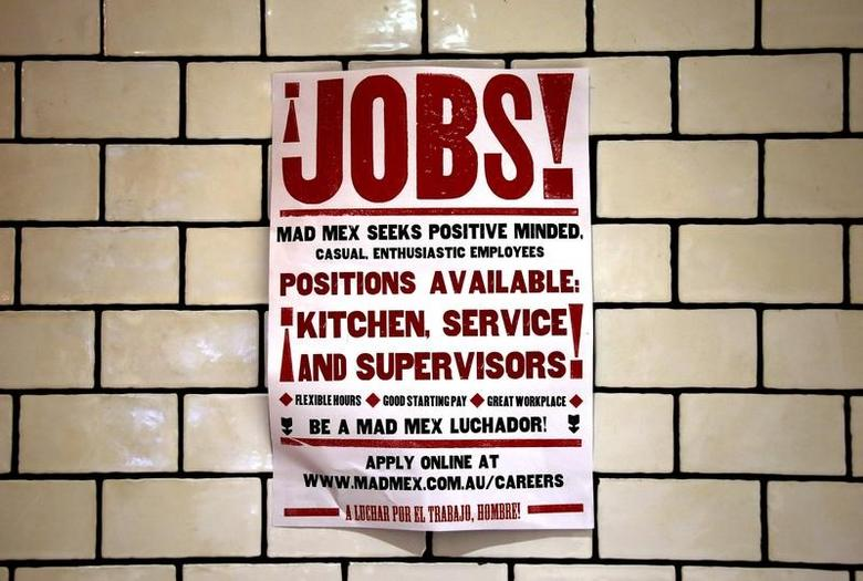 A job advert for a local fast food outlet hangs on a wall in a shopping center located in central Sydney, Australia, in this March 18, 2016 file photo.   REUTERS/David Gray/Files