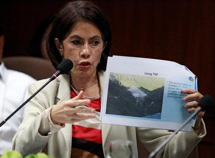 Philippines' Environment and Natural Resources Secretary Regina Lopez shows a picture of Liang tailings storage facility's (TSF) environment compliance certificate (ECC), one of the mining company that has been suspended by the Department of Environment and Natural Resources (DENR) due to vast damage to the environment, during a news conference in Quezon city, Metro Manila, Philippines December 15, 2016. REUTERS/Czar Dancel