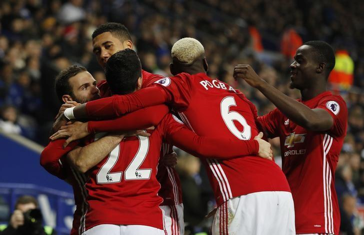Britain Soccer Football - Leicester City v Manchester United - Premier League - King Power Stadium - 5/2/17 Manchester United's Juan Mata celebrates with teammates after scoring their third goal  Reuters / Darren Staples Livepic