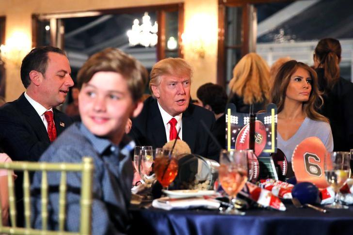 U.S. President Donald Trump and First Lady Melania watch the Super Bowl LI between New England Patriots and Atlanta Falcons, accompanied by White House Chief of Staff Reince Priebus (L) at Trump International Golf club in West Palm Beach, Florida, U.S., February 5, 2017. REUTERS/Carlos Barria