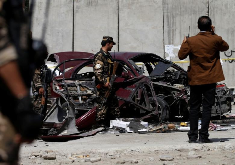 Afghan officials investigate at the site of a bomb blast near the U.S. Embassy in Kabul, Afghanistan August 15, 2016. REUTERS/Mohammad Ismail