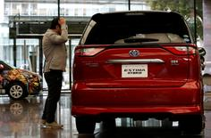 A man looks at Toyota Motor Corp's Estima Hybrid model at its headquarters in Tokyo, Japan, February 6, 2017.  REUTERS/Kim Kyung-Hoon