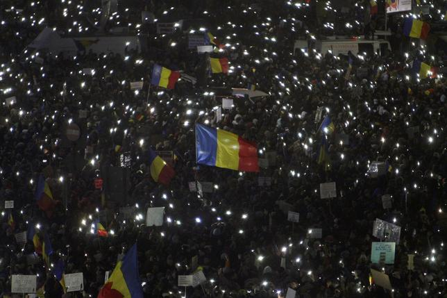 Protesters use phones and flashlights during a protest in Victoriei Square, in Bucharest, Romania, February 5, 2017. Inquam Photos/Adriana Neagoe/via REUTERS