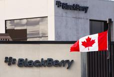 File Photo: A Canadian flag waves in front of a Blackberry logo at the Blackberry campus in Waterloo, September 23, 2013.    REUTERS/Mark Blinch/File Photo