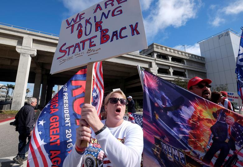 File Photo: Demonstrators in support of the immigration rules implemented by U.S. President Donald Trump's administration, rally at Los Angeles international airport in Los Angeles, California, U.S., February 4, 2017. REUTERS/Ringo Chiu/File Photo