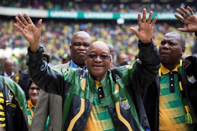 South African President Jacob Zuma greets supporters at a rally to commemorate the 105th birthday of his ruling African National Congress (ANC), in Soweto, South Africa January 8, 2017. REUTERS/James Oatway