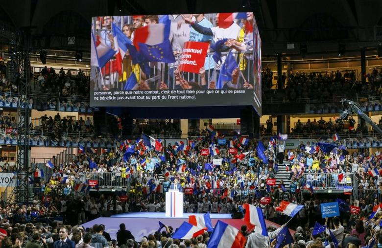 Emmanuel Macron, head of the political movement En Marche !, or Onwards !, and candidate for the 2017 presidential election, delivers a speech during a campaign rally in Lyon, France, February 4, 2017. REUTERS/Robert Pratta