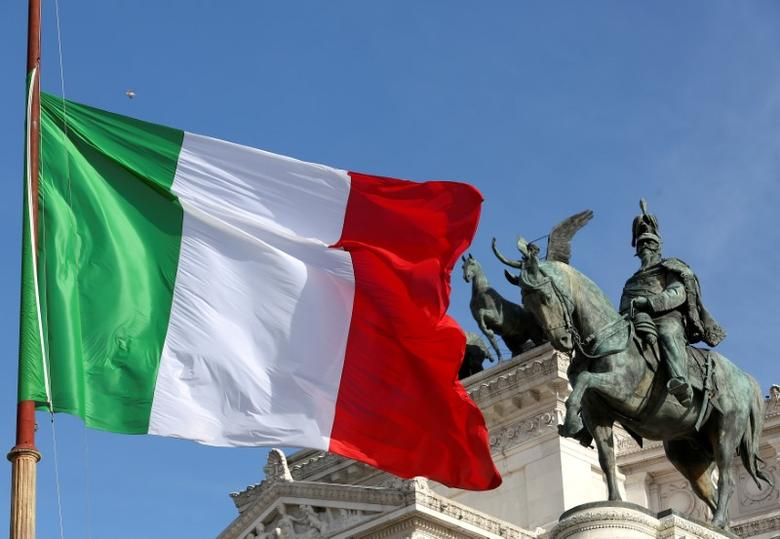 The Italian flag waves in front of The ''Altare della Patria'' also known as ''Vittoriano'' downtown Rome, Italy, March 23, 2016.  REUTES/ Stefano Rellandini