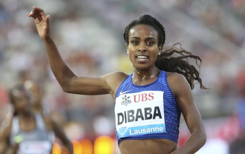 Athletics - IAAF Athletics Diamond League meeting Lausanne -  Stade Olympique de la Pontaise, Lausanne, Switzerland - 25/8/2016 - Genzebe Dibaba of Ethiopia celebrates winning the women's 3,000 m competition.  REUTERS/Denis Balibouse
