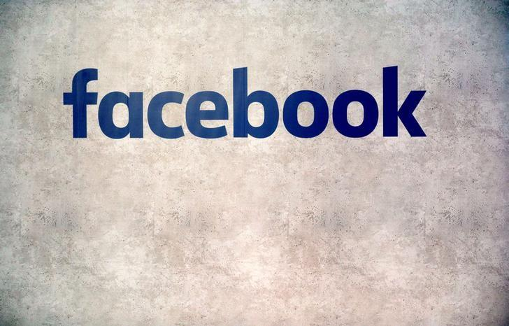 Facebook logo is seen on a wall at a start-up companies gathering at Paris' Station F in Paris, France, January 17, 2017.   REUTERS/Philippe Wojazer