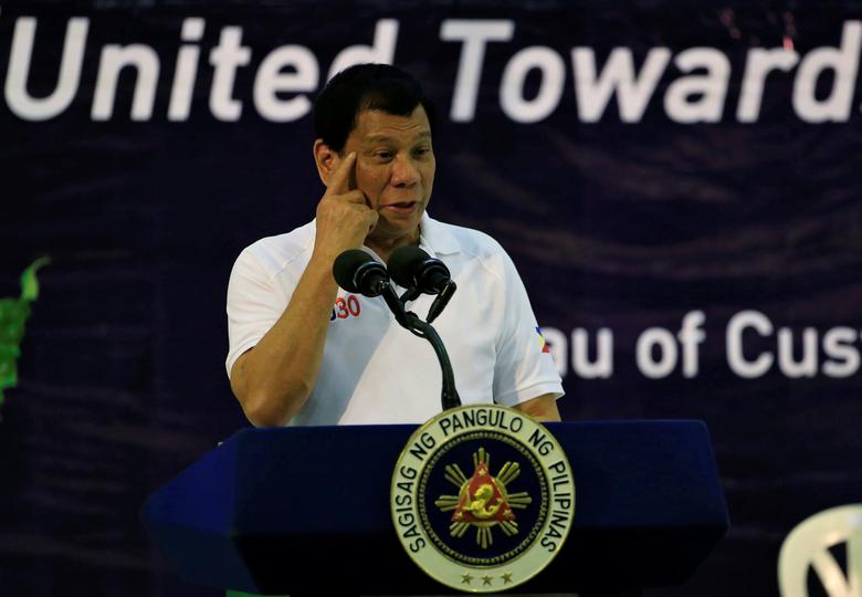 Philippine President Rodrigo Duterte gestures while delivering a speech during the 115th founding  anniversary of the Bureau of Customs in metro Manila, Phillippines February 8, 2017. REUTERS/Romeo Ranoco
