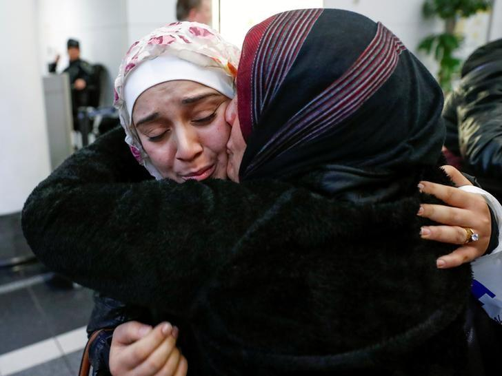 Syrian refugee Baraa Haj Khalaf (L) is greeted by her mother Fattoum Haj Khalaf after arriving at O'Hare International Airport in Chicago, Illinois, U.S. February 7, 2017. REUTERS/Kamil Krzaczynski