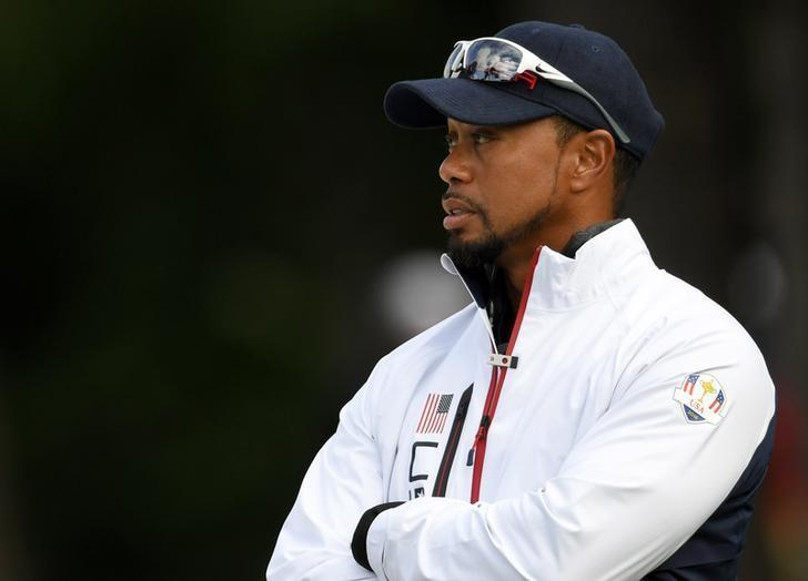 Team USA vice-captain Tiger Woods talk at the 13th green during the practice round for the Ryder Cup at Hazeltine National Golf Club in Chaska, Minnesota, September 28, 2016.  Mandatory Credit: Michael Madrid-USA TODAY Sports