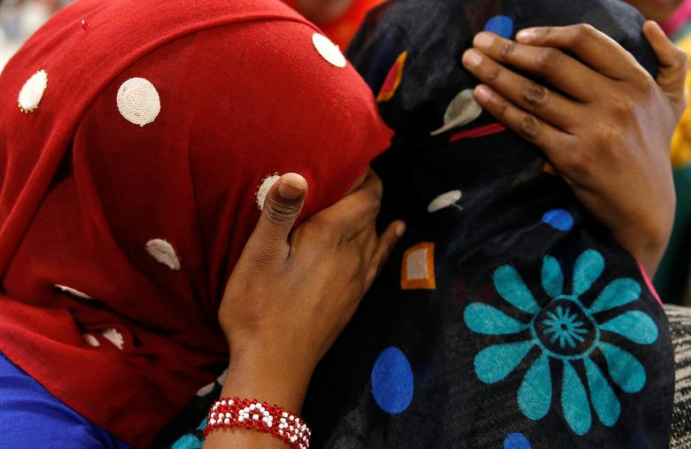 Asma Abdinasir (L), a Somali national who was initially denied entry to the U.S. because of the recent travel ban, is greeted by her mother Zahra Warsma (R) at Washington Dulles International Airport in Chantilly, Virginia, U.S. February 6, 2017.  REUTERS/Jonathan Ernst