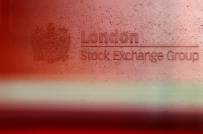 A red London bus passes the Stock Exchange  in London February 9, 2011. The London Stock Exchange is to buy the owner of the Toronto Stock Exchange TMX Group in an all share deal that will create a mining-dominant exchange at a time of rising commodity prices. REUTERS/Luke MacGregor