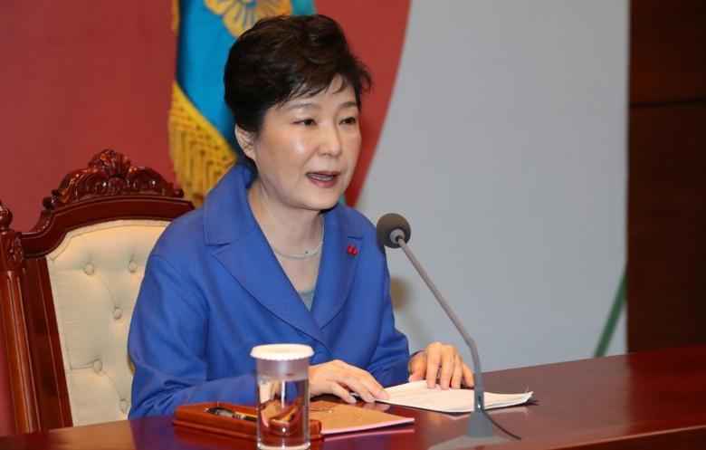 South Korean President Park Geun-hye speaks during an emergency cabinet meeting at the Presidential Blue House in Seoul, South Korea, December 9, 2016. Yonhap/ via REUTERS