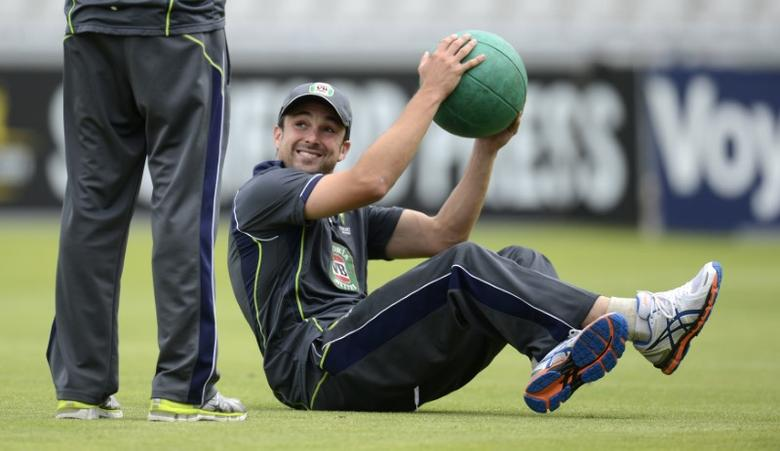 Australia's Ed Cowan smiles during a training session at Old Trafford cricket ground in Manchester July 30, 2013. REUTERS/Philip Brown