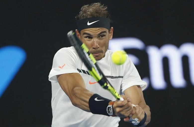Tennis - Australian Open - Melbourne Park, Melbourne, Australia - 29/1/17 Spain's Rafael Nadal hits a shot during his Men's singles final match against Switzerland's Roger Federer. REUTERS/Thomas Peter