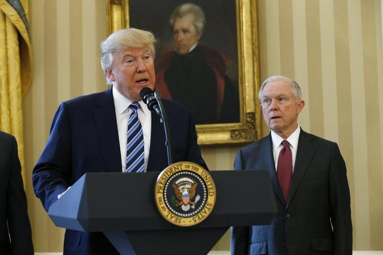 U.S. President Donald Trump speaks during a swearing-in ceremony for new Attorney General Jeff Sessions (R)  at the White House in Washington, U.S., February 9, 2017. REUTERS/Kevin Lamarque