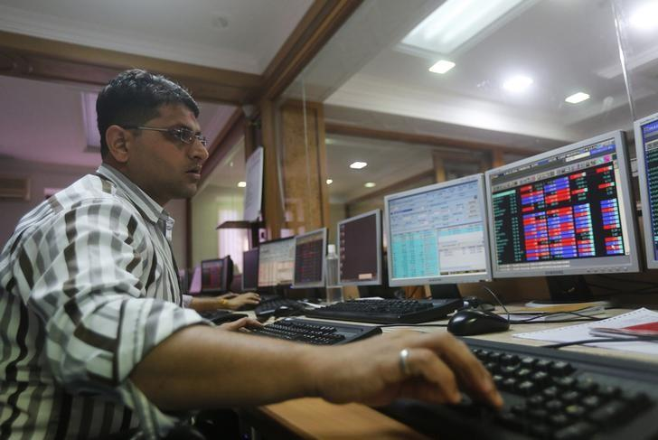 A broker trades on his computer terminal at a stock brokerage firm in Mumbai, India, January 20, 2016. REUTERS/Shailesh Andrade/Files