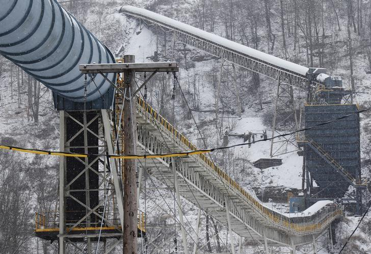 A load out line at the Century Mine carries cleaned coal to a transport area near Beallsville, Ohio, January 25, 2013. While cities such as Pittsburgh have recovered from the decline of coal and steel, rural areas such as the Ohio Valley have been largely left behind. Four or five mines operate in an area that once had 25, veteran miners say. Picture taken January 25, 2013. REUTERS/Jason Cohn
