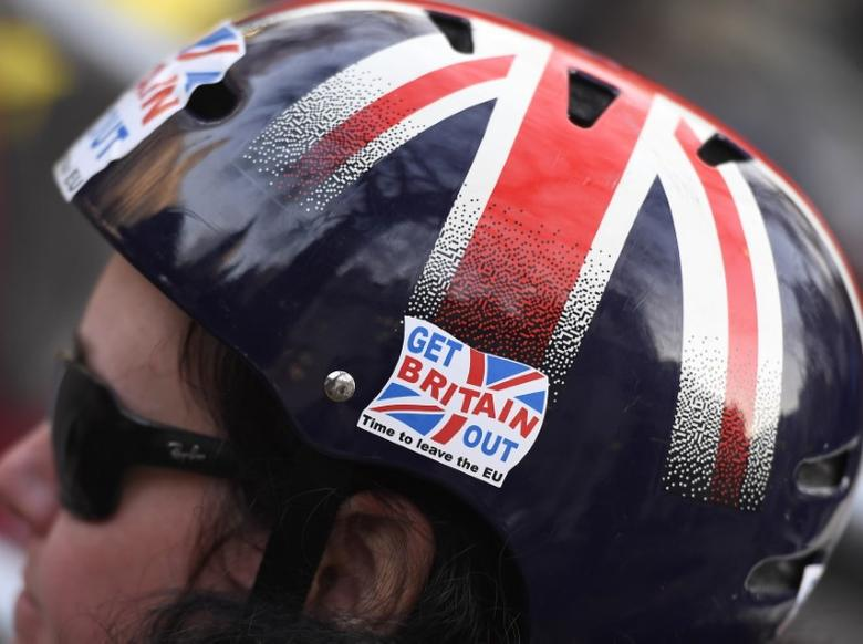 A cyclist wears a pro-Brexit badge on her Union flag themed helmet outside the Supreme Court on the first day of the challenge against a court ruling that Theresa May's government requires parliamentary approval to start the process of leaving the European Union, in Parliament Square, central London, Britain December 5, 2016. REUTERS/Toby Melville