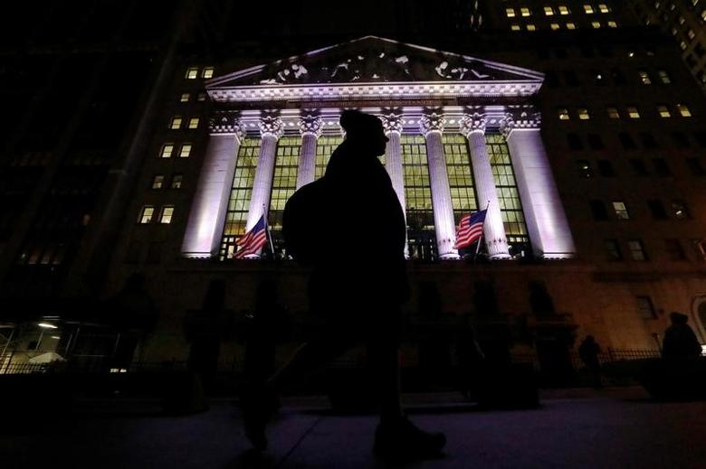A commuter passes by the New York Stock Exchange (NYSE) in the financial district in New York City, U.S., February 7, 2017. REUTERS/Brendan McDermid -