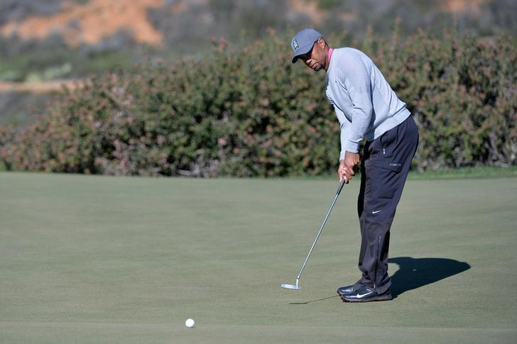 Jan 27, 2017; La Jolla, CA, USA; Tiger Woods putts on the 12th green during the second round of the Farmers Insurance Open golf tournament at Torrey Pines Municipal Golf Course - North Co. Mandatory Credit: Orlando Ramirez-USA TODAY Sports