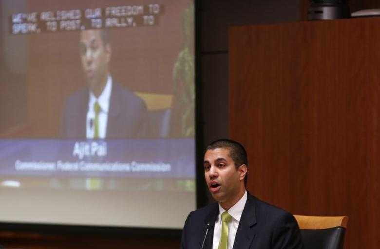 FILE PHOTO - Federal Communications Commission (FCC) commissioner Ajit Pai speaks at a FCC Net Neutrality hearing in Washington February 26, 2015. REUTERS/Yuri Gripas