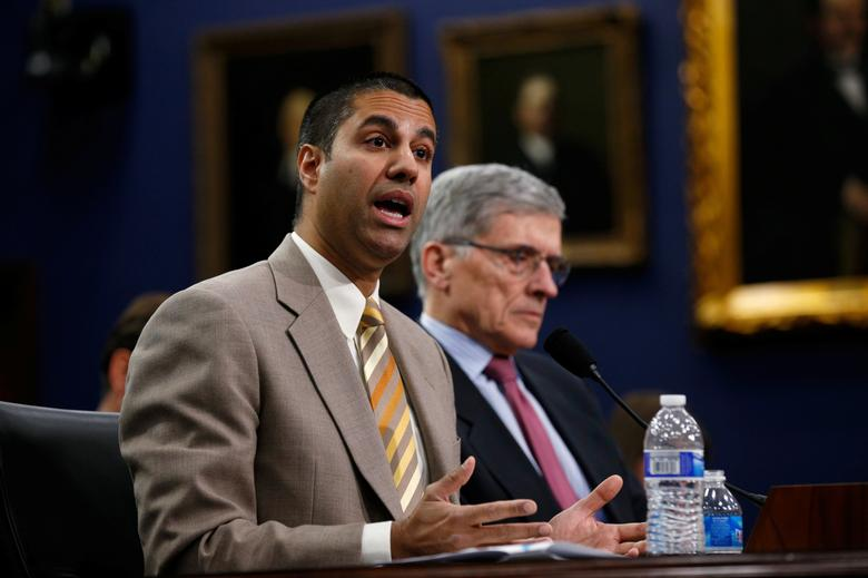 FILE PHOTO --  Federal Communications Commission (FCC) Commissioner Ajit Pai (L) and FCC Chairman Tom Wheeler testify at a House Appropriations Financial Services and General Government Subcommittee hearing on the FCC's FY2016 budget, on Capitol Hill in Washington March 24, 2015. REUTERS/Kevin Lamarque/File Photo