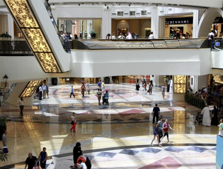 People shop at the Mall of the Emirates in Dubai June 26, 2012. REUTERS/Ghazal Watfa
