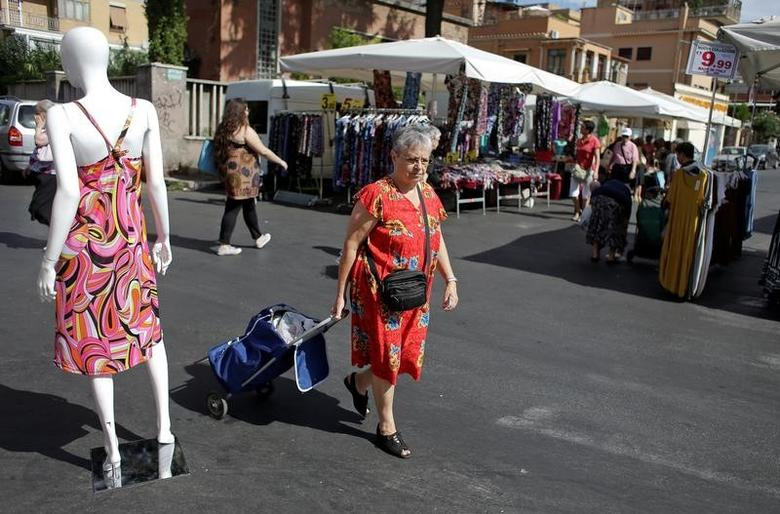 A woman walks in a street market in Rome, Italy, August 11, 2016. Picture taken August 11, 2016. REUTERS/Max Rossi