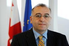Глава Нацбанка Грузии Коба Гвенетадзе в своем офисе в Тбилиси. 11 июля 2016 года. Национальный банк Грузии ожидает, что инфляция превысит целевой показатель в 4 процента в текущем году, и планирует сдержанное ужесточение монетарной политики в среднесрочной преспективе, сказал глава Нацбанка Коба Гвенетадзе. REUTERS/David Mdzinarishvili
