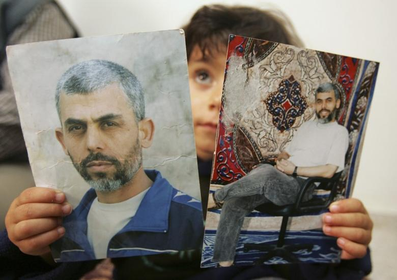 A relative of Yehya al-Sinwar, a top Hamas armed commander whose name was among other name of Palestinian faction leaders Hamas wants freed within a possible prisoner swap with Israel, poses with his picture at his home in the southern Gaza strip April 8, 2007. REUTERS/Mohammed Salem