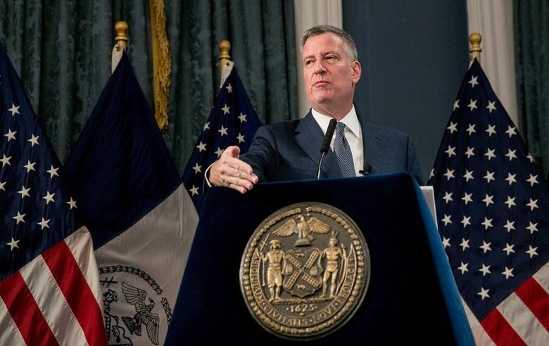 FILE PHOTO --  New York City Mayor Bill de Blasio presents the Fiscal Year 2018 Preliminary Budget at New York City Hall in New York, U.S., January 24, 2017.  REUTERS/Sam Hodgson/The New York Times/Pool/File Photo