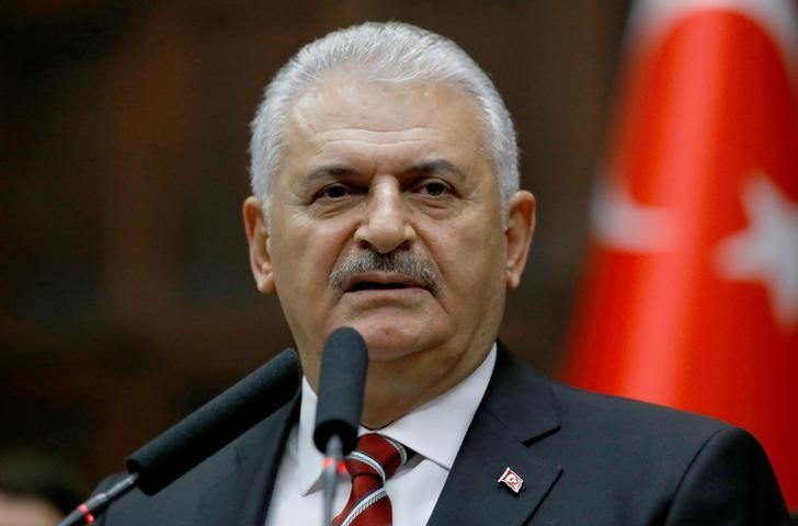 Turkey's Prime Minister Binali Yildirim addresses members of parliament from his ruling AK Party (AKP) during a meeting at the Turkish parliament in Ankara, Turkey, November 8, 2016. REUTERS/Umit Bektas/Files
