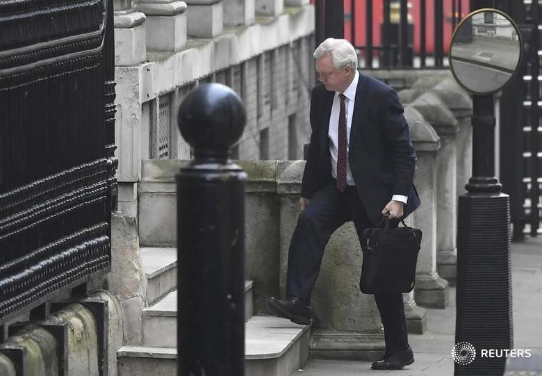 Britain's Brexit Secretary David Davis walks into his office in Downing Street in London, Britain, February 8, 2017. REUTERS/Toby Melville